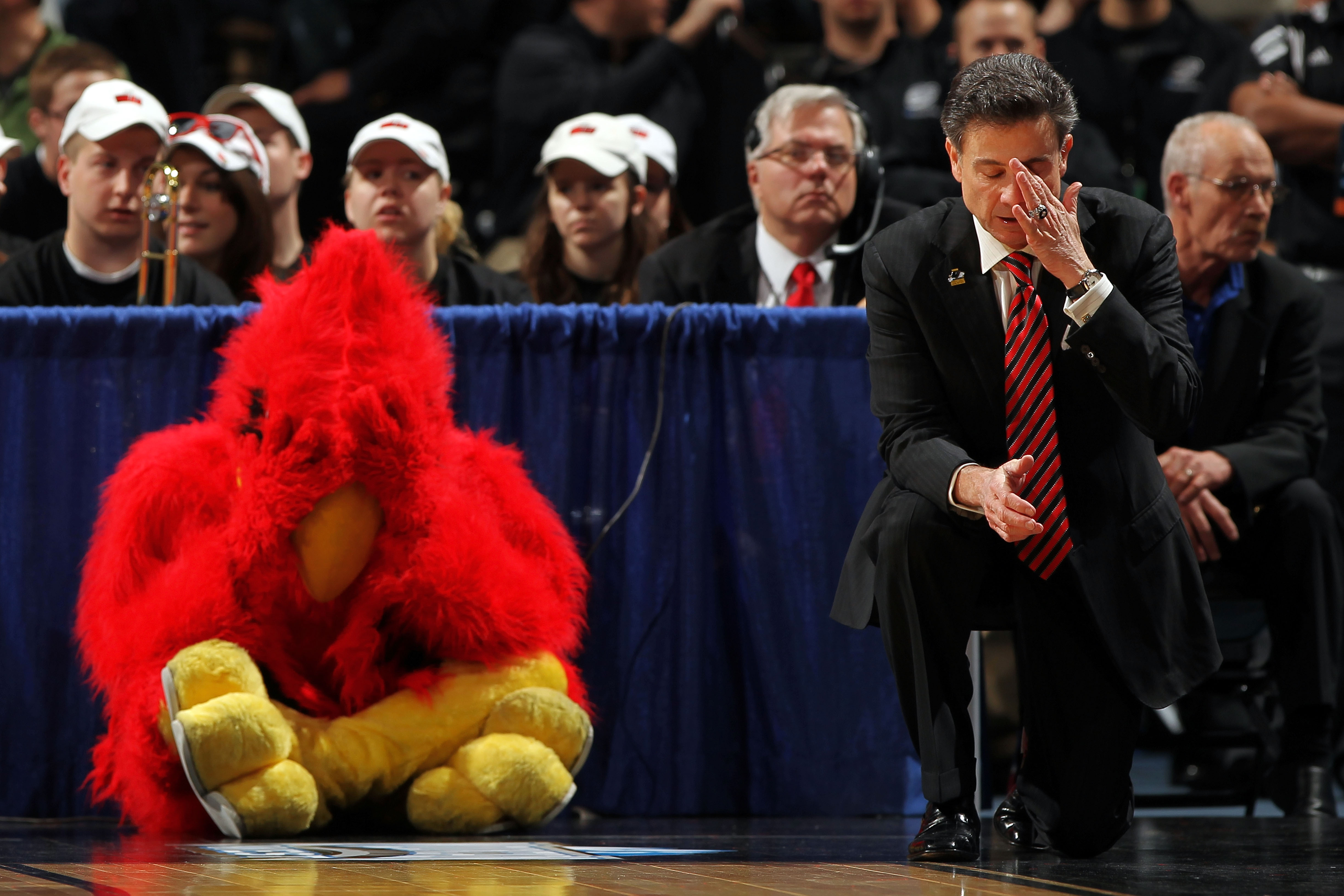 DENVER, CO - MARCH 17:  Head coach Rick Pitino of the Louisville Cardinals and the teams mascot react after a play while playing against the Morehead State Eagles during the second round of the 2011 NCAA men's basketball tournament at Pepsi Center on March 17, 2011 in Denver, Colorado.  (Photo by Doug Pensinger/Getty Images)