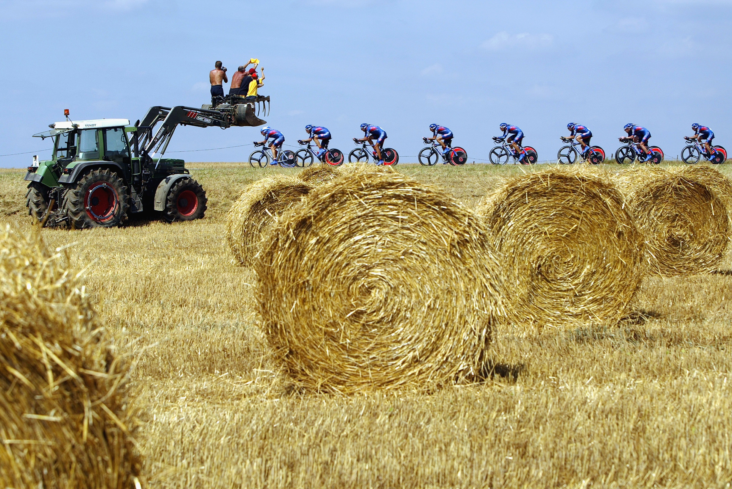 JOINVILLE, FRANCE - JULY 9:  Lance Armstrong (far left) of the United States leads the US Postal-Berry Floor team as they travel through the agricultural fields of France to win the team time trial in stage four of the Tour de France from Joinville to Saint-Dizier on July 9, 2003 in France.  Armstrong went on to win his fifth Tour de France title.  (Photo by Doug Pensinger/Getty Images)