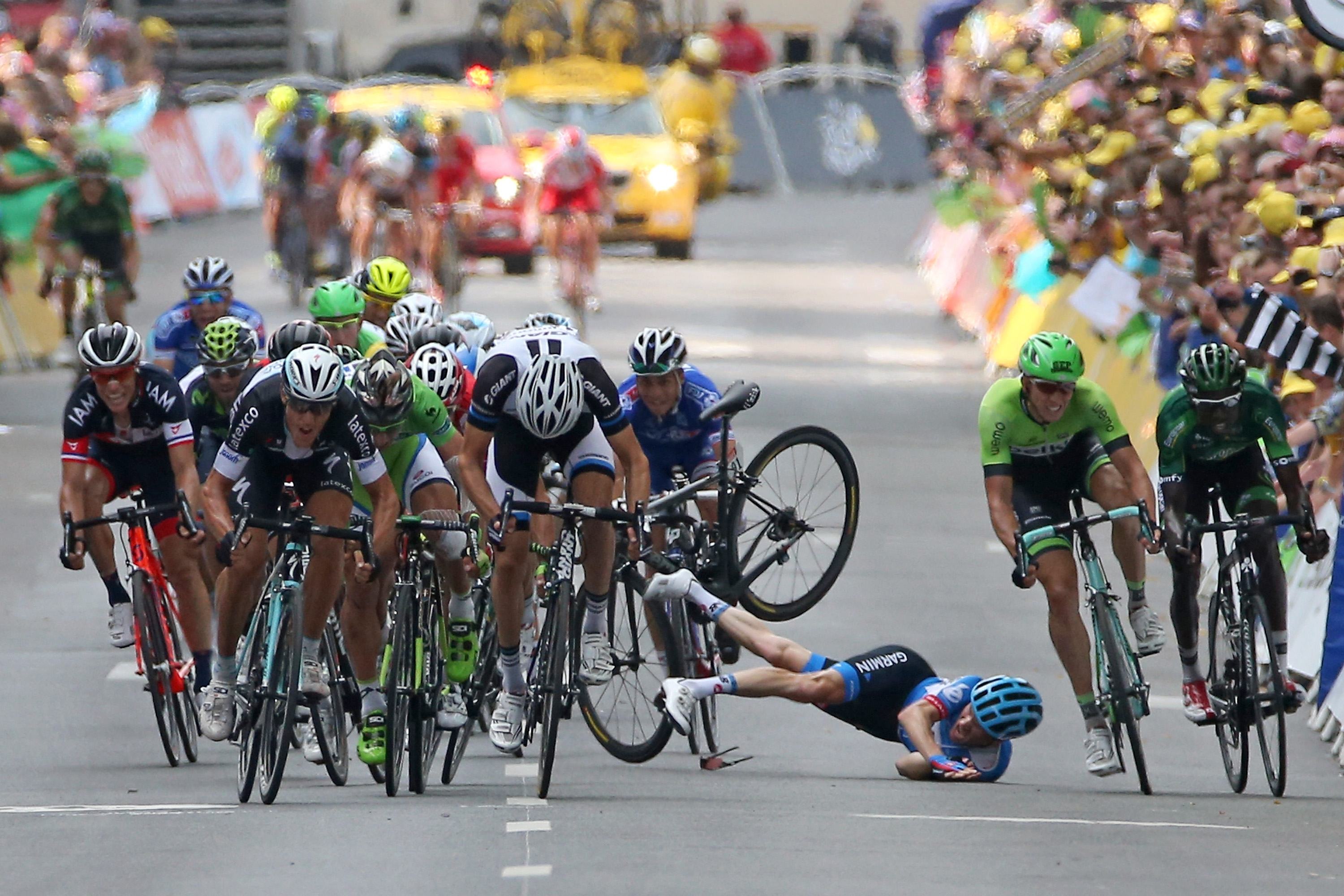 NANCY, FRANCE - JULY 11:  Andrew Talansky of the United States and Garmin-Sharp crashes in the sprint to the finish line in stage seven of the 2014 Le Tour de France from Epernay to Nancy on July 11, 2014 in Nancy, France.  (Photo by Doug Pensinger/Getty Images)