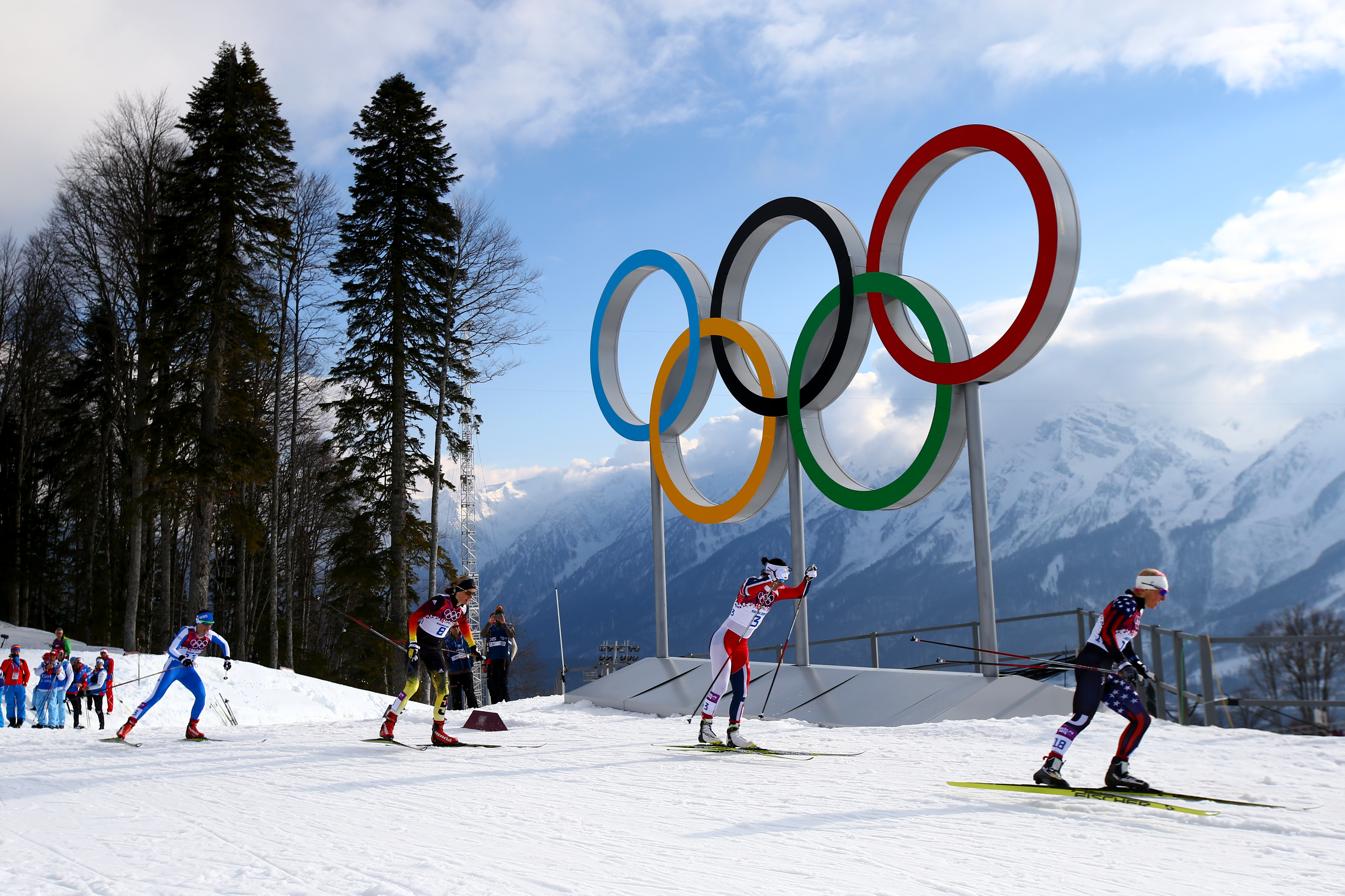 SOCHI, RUSSIA - FEBRUARY 11:  Kikkan Randall of the United States (R) leads the pack in Finals of the Ladies' Sprint Free during day four of the Sochi 2014 Winter Olympics at Laura Cross-country Ski & Biathlon Center on February 11, 2014 in Sochi, Russia.  (Photo by Doug Pensinger/Getty Images)